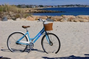 Picture of a bike in the sand along the Falmouth coastline.