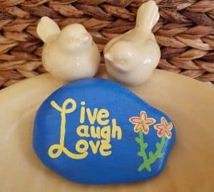 Picture of a Kindness Rocks rock that says Live Laugh Love