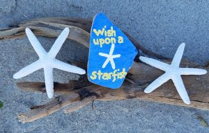 Picture of a Kindness Rocks rock that says Wish upon a starfish